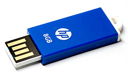A slim flash drive with the monolithic chip on a plastic slider. The plastic slider has no support so if bumped it WILL break the monolithic chip